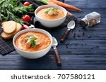 bowls with delicious carrot... | Shutterstock . vector #707580121