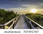 the wooden peer to the beach  | Shutterstock . vector #707591707