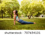 asian woman practicing yoga in... | Shutterstock . vector #707654131