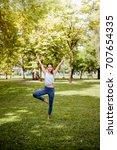asian woman practicing yoga in... | Shutterstock . vector #707654335