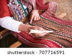 hands of peruvian woman making... | Shutterstock . vector #707716591