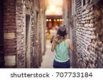 girl with a hat walking and... | Shutterstock . vector #707733184