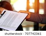 paperwork   businessman holds... | Shutterstock . vector #707742361