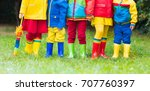 Kids In Rain Boots. Group Of...