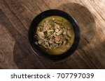 Small photo of Mixed vegetables and mushroom spicy curry soup with banana stalk pith and chicken,Kaeng youk,Thai style food