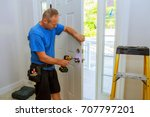 installation of a lock on the... | Shutterstock . vector #707797201