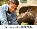Stock photo boy visits jonathan the tortoise on st helena jonathan the famous giant tortoise who is estimated 70780846