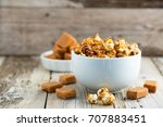 caramel covered popcorn and... | Shutterstock . vector #707883451