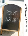 Small photo of Rooms Available sign outside hotel