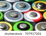 Small photo of An appearance colorful reflective surface of used battery, anode side, AA size, 1.5 v. Both recharge and non rechargeable. close up.