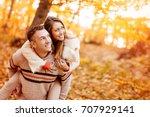 beautiful young couple enjoying ... | Shutterstock . vector #707929141