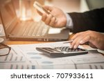 a businessman analyzing... | Shutterstock . vector #707933611