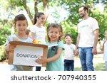 young volunteers and children... | Shutterstock . vector #707940355