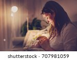 young beautiful mother ... | Shutterstock . vector #707981059