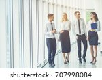 the business people walk in the ... | Shutterstock . vector #707998084