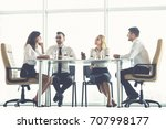 the four business people sit at ... | Shutterstock . vector #707998177