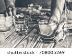 Small photo of black and white. A young girl is preparing an alcoholic or non-alcoholic cocktail. hands, bartender, bar, restaurant, mint, lime, lemon, alcoholic, non-alcoholic