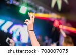peace hand sign on a night event | Shutterstock . vector #708007075
