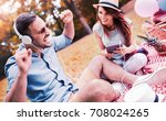 picnic time. young smiling... | Shutterstock . vector #708024265