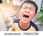 little asian boy crying bitterly | Shutterstock . vector #708031789