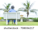 older woman sit alone on bench  ... | Shutterstock . vector #708036217
