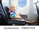 child in airplane. kid in air... | Shutterstock . vector #708037939