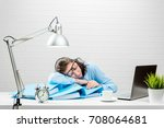 tired accountant during the... | Shutterstock . vector #708064681