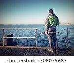 travel photographer on pier....   Shutterstock . vector #708079687