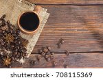 cup of coffee with cinnamon and ...   Shutterstock . vector #708115369