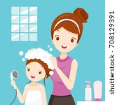 mother washing daughter hair in ... | Shutterstock .eps vector #708129391