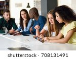 five young people studying with ... | Shutterstock . vector #708131491