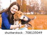 Teen Girl Holding Her Pet ...