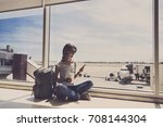 young woman in the airport ... | Shutterstock . vector #708144304