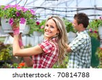 Gardening. Young Smiling Peopl...