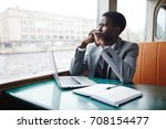 young analyst in suit thinking... | Shutterstock . vector #708154477