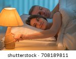 the woman sleeping on the bed... | Shutterstock . vector #708189811