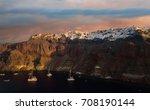the famous sunset at santorini... | Shutterstock . vector #708190144