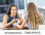 two angry girls talking... | Shutterstock . vector #708190915