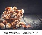 mushroom boletus over wooden... | Shutterstock . vector #708197527