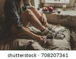 cozy home. woman with cup of... | Shutterstock . vector #708207361