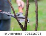 gardener pruning branch with...   Shutterstock . vector #708216775