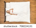 the young woman lay on the bed... | Shutterstock . vector #708224131