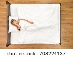 the woman sleeping on the bed.... | Shutterstock . vector #708224137
