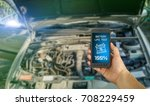 man checking car battery charge ... | Shutterstock . vector #708229459