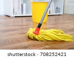 cleaning tools on parquet floor  | Shutterstock . vector #708252421