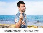 handsome man with flower shirt... | Shutterstock . vector #708261799