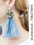 fashion earring on the ear.... | Shutterstock . vector #708275845