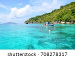 the little boat on blue sea at... | Shutterstock . vector #708278317