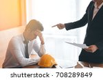 Small photo of Two engineer or businessman Boss complain the Mistake to another