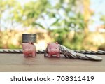 Small photo of Compare success and failure concept, piggy carry coins and money fall on wood table